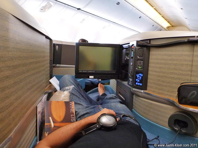 "My ""bed"" on the Cathay Pacific flight from HKG to LAX."