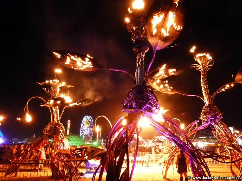 "EDC is full of unusual decorations – everything from tesla coils and giant robotic creatures to these odd ""burning tree"" sculptures."