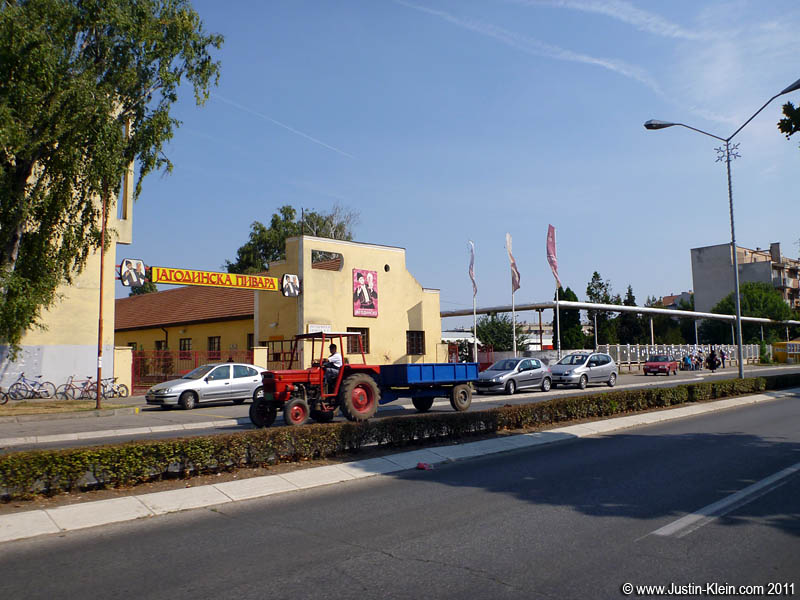 A tractor driving past the Jagodina Brewery.