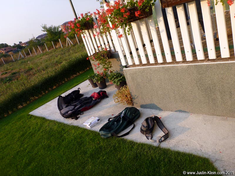 We did have one little emergency during my stay.  One day while Branko was out in his workshop and I was programming with headphones, a pipe in the bathroom burst.  Water poured out onto the floor for probably half an hour before I noticed, flooding the bedroom and hallway.  My luggage was 50% underwater (shown here drying in the back yard).  Thank God that all of my electronics were at the top, so nothing critical got ruined (except for my Lonely Planet – the last few chapters had all the highlighting washed away).  Even more amazing was that my laptop power brick, COMPLETELY submerged underwater, continued to work!  Go, Dell.