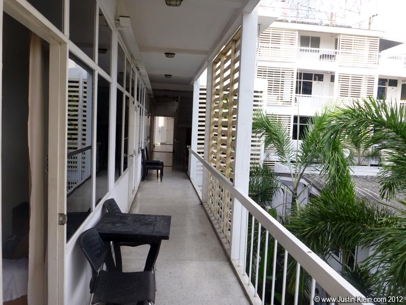 The walkway to my room.  The only thing I really don't like is that the windows are tinted, making it not very bright inside.  It may become a problem after awhile, but at least for now it's a wonderful change from Sukhumvit Soi 4.