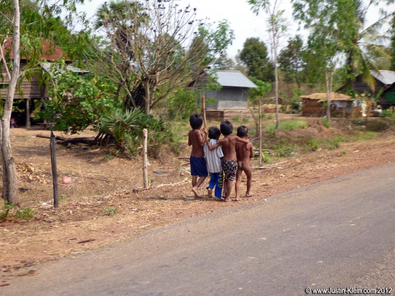 Local children strolling along the main road into town.