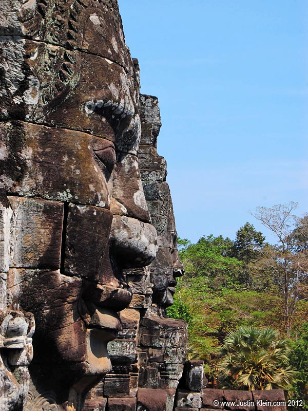 Giant stone faces at the Bayon, gazing peacefully into the jungle for the last eight hundred years.
