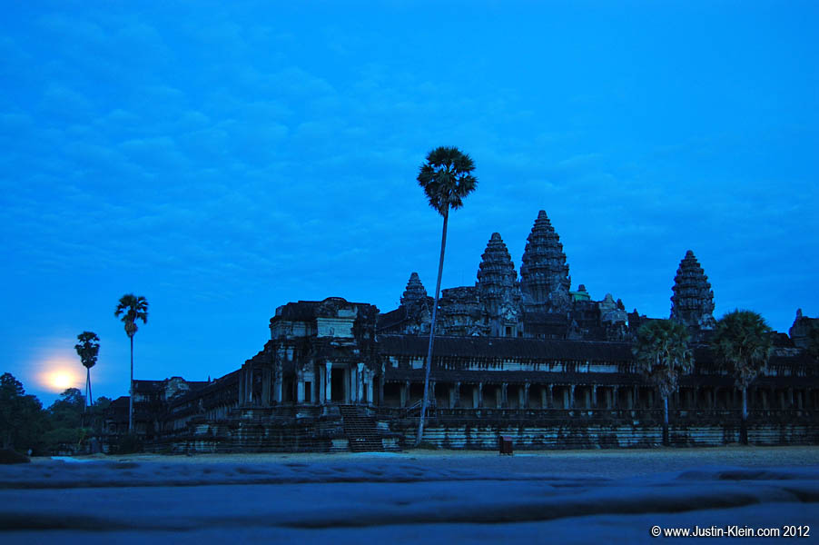 The moon rising over Angkor Wat.