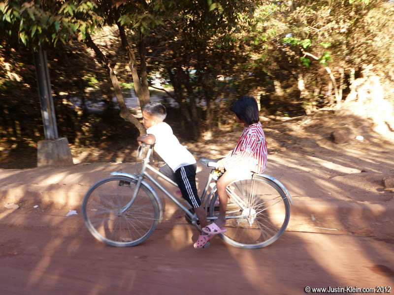 In Cambodia, you often see kids riding bikes twice their size.  Incredibly cute.