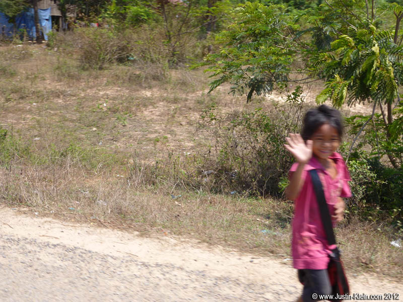 100% of Cambodian kids smile and waive when you pass by.  Very cute.