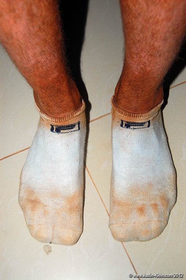 Most of the roads in Cambodia are bright red dirt.  The lesson: don't wear white socks.
