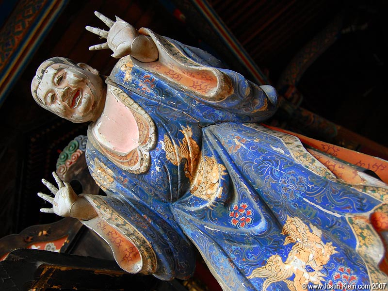 A withering statue in a Kyoto temple