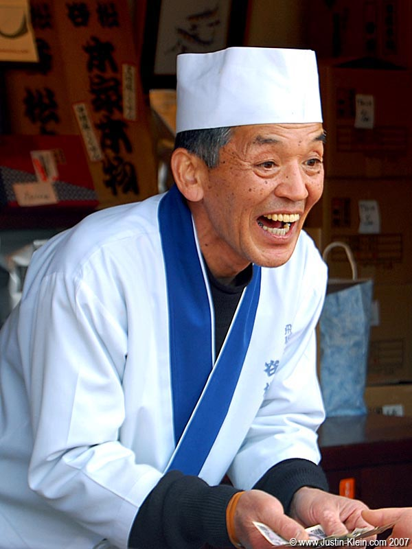 An extremely happy cracker-maker in Takayama