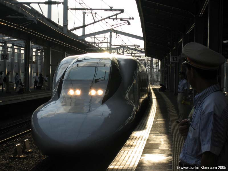 A bullet train pulls into Kyoto Station (Post)