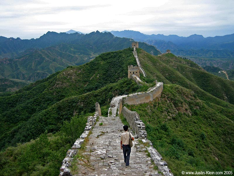 A local farmer goes for a stroll on the Great Wall of China
