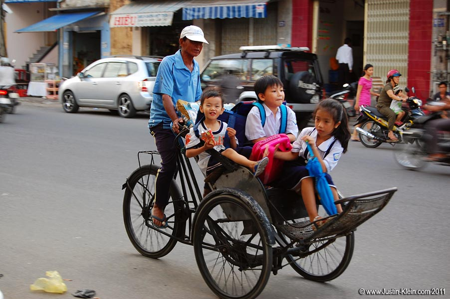 "A local ""schoolbus"" zooms by in Nha Trang, Vietnam"